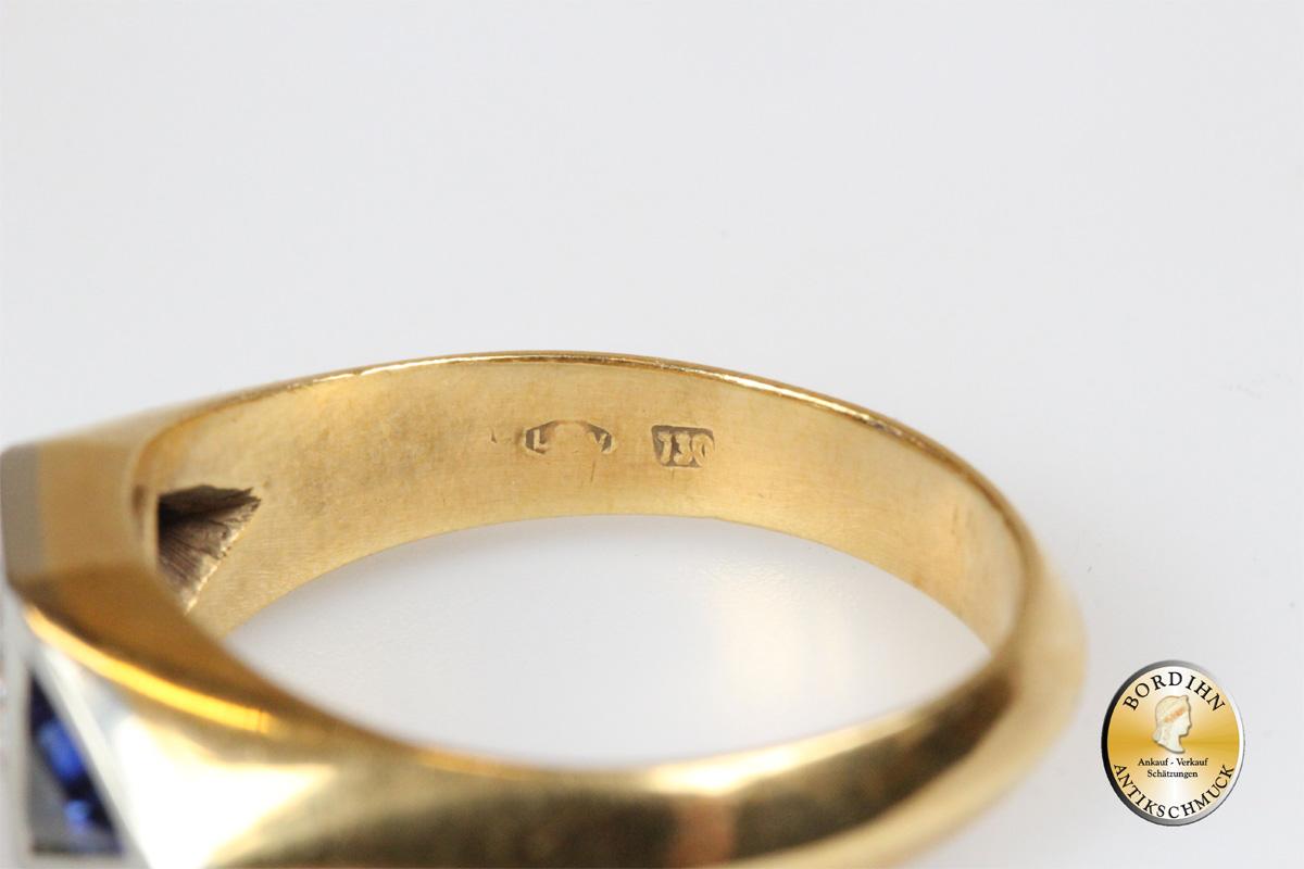 Ring; 18 Karat Gold mit Brillant und Saphir