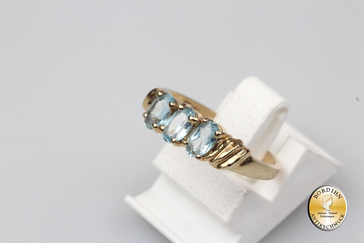 Ring; 14 Karat Gold mit blauen Farbsteinen
