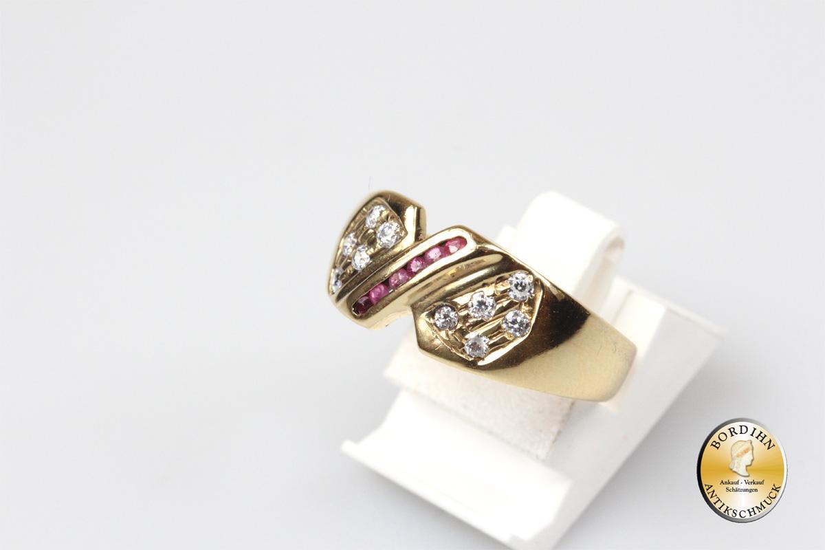 Ring; 18 Karat Gold mit Cirkonia und Rubin