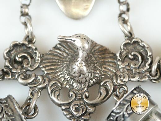 Rockstecker; 835 Silber, mit Gamskopf und Schaukel