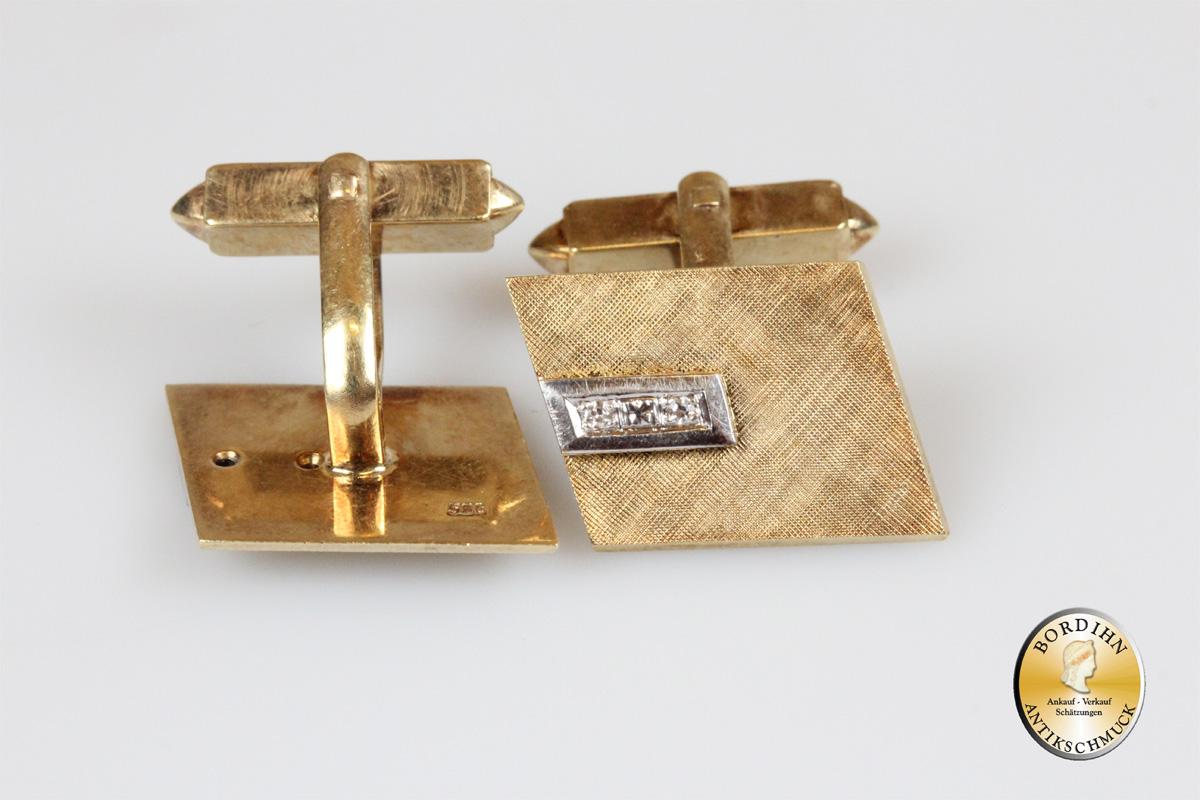 Manschettenknöpfe; 14 Karat Gold, 4 Brillanten