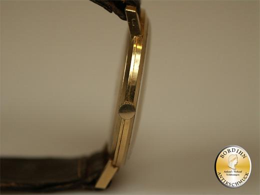 Armbanduhr; 18 Karat Gold, Marke EMKA, Schweiz
